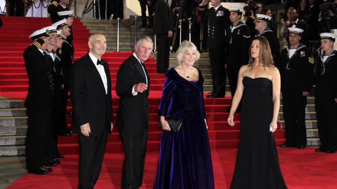 """Michael G. Wilson, from left, Prince Charles, Camilla Parker-Bowels and Barbara Broccoli arrive at the world premiere of """"Skyfall"""" at the Royal Albert Hall on Tuesday, Oct. 23, 2012 in London. (Photo by Joel Ryan/Invision/AP)"""