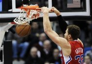 Los Angeles Clippers' Blake Griffin dunks during the first half of an NBA basketball game against the Minnesota Timberwolves, Thursday, Jan. 17, 2013, in Minneapolis. (AP Photo/Jim Mone)