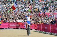France&#39;s Julie Bresset celebrates as she wins the women&#39;s cycling cross-country mountain bike race of the London 2012 Olympic Games on August 11, 2012 at Hadleigh Farm in Benfleet. AFP PHOTO / CARL DE SOUZA