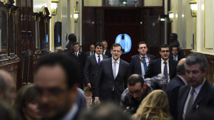 Spain's Prime Minister Mariano Rajoy leaves after delivering a speech during the state of the nation debate at the Spanish Parliament in Madrid, Spain, Wednesday, Feb. 20, 2013. (AP Photo/Andres Kudacki)