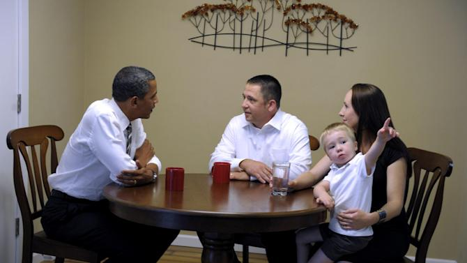 President Barack Obama talks with Jason and Ali McLaughlin and their son Cooper while visiting their home in Cedar Rapids, Iowa, Tuesday, July 10, 2012. (AP Photo/Susan Walsh)