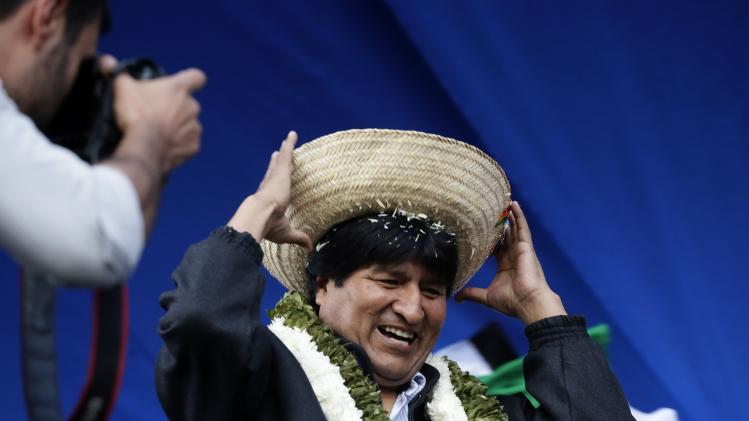 Bolivia's President Morales puts on a hat during a presidential election campaign meeting in La Paz