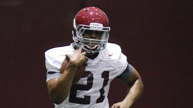 FILE - In this Aug. 5, 2011 file photo, Alabama's Brent Calloway (21) carries the ball during football practice in Tuscaloosa, Ala. Calloway has been arrested by police in Tuscaloosa and charged with possession of marijuana. (AP Photo/The Tuscaloosa News, Michelle Lepianka Carter, File)