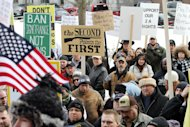 Hundreds of gun supporters rally at the Statehouse, Saturday, Jan. 19, 2013 in Concord, N.H. Rallies are being held by gun rights advocates four days after President Barack Obama unveiled a sweeping plan to curb gun violence. (AP Photo/Jim Cole)