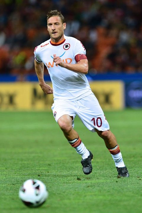 AS Roma's forward Francesco Totti runs for the ball in the match against AC Milan in Milan  on May 12, 2013