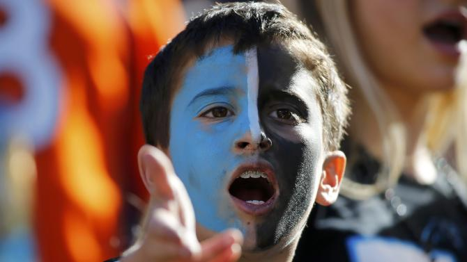 A young Carolina Panthers fan yells from the stands before the NFL's Super Bowl 50 football game between the Panthers and the Denver Broncos in Santa Clara