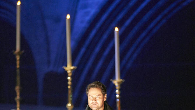 """In this March 2, 2013 photo provided by the Vienna State Opera Ildar Abdrazakov in the role of Don Giovanni performs during a dress rehearsal for Wolfgang Amadeus Mozart's  opera """"Don Giovanni"""" at the state opera in Vienna, Austria. (AP Photo/Vienna State Opera, Michael Poehn)"""