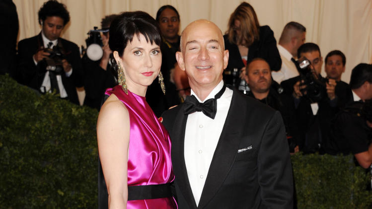 "FILE - In this May 7, 2012 file photo, Amazone founder, president and CEO Jeff Bezos and wife Mackenzie Bezos arrive at the Metropolitan Museum of Art Costume Institute gala benefit, celebrating Elsa Schiaparelli and Miuccia Prada, in New York. Mackenzie Bezos is giving a thumbs-down to a recent book about her husband's company, Amazon.com Inc. On Monday, Nov. 4, 2013, she posted a one-star review on the Amazon page for Brad Stone's ""The Everything Store,"" which came out last month and has been received positively by critics and Amazon readers. (AP Photo/Evan Agostini, File)"