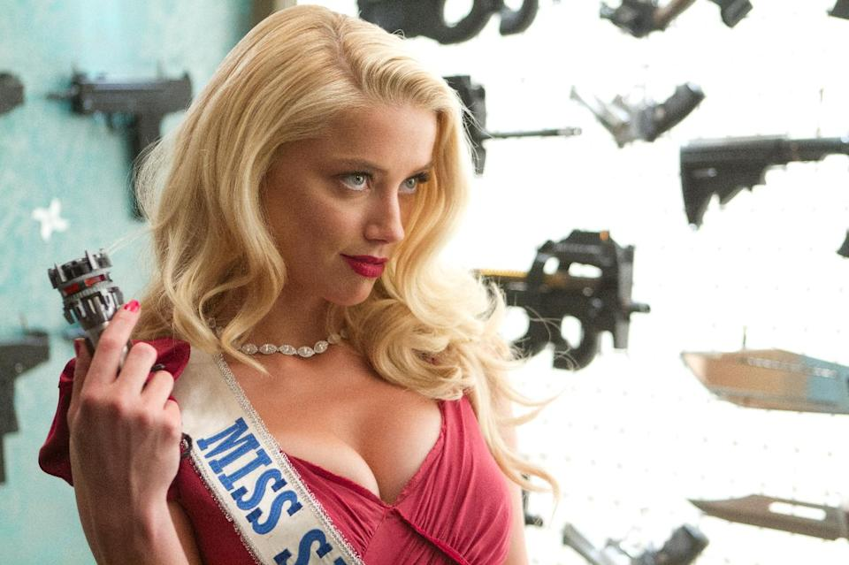 "This image released by Open Road Films shows Amber Heard in a scene from ""Machete Kills."" (AP Photo/Open Road Films, Rico Torres)"