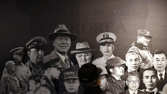 A man looks at a banner of defenders of freedom from South Korea and the United States during the Korean War at the Korea War Memorial Museum in Seoul, South Korea, Wednesday, March 6, 2013. North Korea's military is vowing to cancel the 1953 cease-fire that ended the Korean War, straining already frayed ties between Washington and Pyongyang as the United Nations moves to impose punishing sanctions over the North's recent nuclear test. (AP Photo/Lee Jin-man)