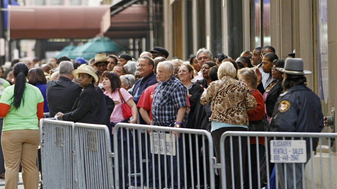 FILE - In this Monday May 14, 2012 file photo, visitors line up outside the Horseshoe Casino Cleveland waiting for the 9:30 p.m. opening of Ohio's first casino. Ohio's entry into casino gambling this spring isn't good news for its neighboring states. States including Indiana, Michigan and Pennsylvania are likely to lose millions in tax revenues as more Ohioans stay home to gamble. That could mean less money for new schools, college scholarships, roads and bridges. (AP Photo/Mark Duncan)