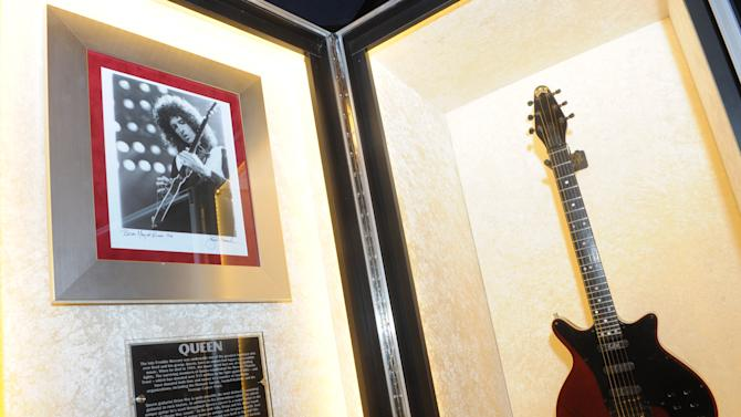 "Brian May's Guild ""Red Special"" guitar is displayed at the launch of Hard Rock International's traveling music memorabilia collection, ""Music Gives Back,"" Wednesday, Feb. 13, 2013, at Hard Rock Cafe New York.   ""Music Gives Back"" focuses on artists who have worked with Hard Rock on charitable campaigns  and will be on tour at Hard Rock locations in the U.S. throughout 2013. (Photo by Diane Bondareff/Invision for Hard Rock International/AP Images)"