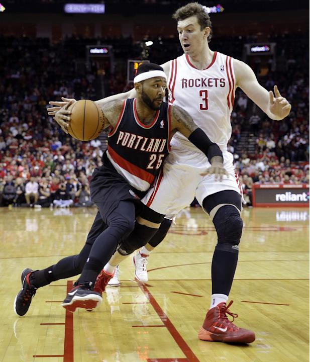 Portland Trail Blazers' Mo Williams (25) drives toward the basket as Houston Rockets' Omer Asik (3) defends during the first quarter of an NBA basketball game on Sunday, March 9, 2014, in Hous