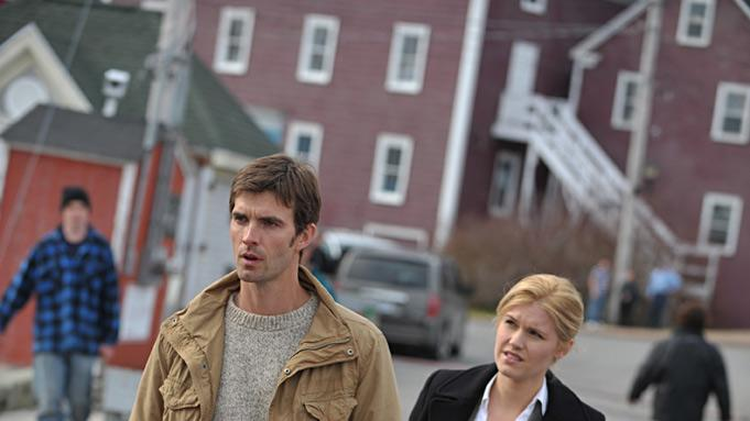 "Emily Rose as Audrey Parker and Lucas Bryant as Nathan Wuomos in ""Haven."""