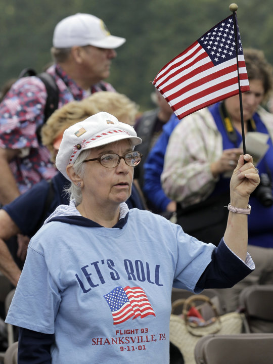 Ethel Stevanus of Wellersburg, Pa. sings along to a patriotic medley during the dedication of phase I of the permanent Flight 93 National Memorial near the crash site of Flight 93 in Shanksville, Pa.