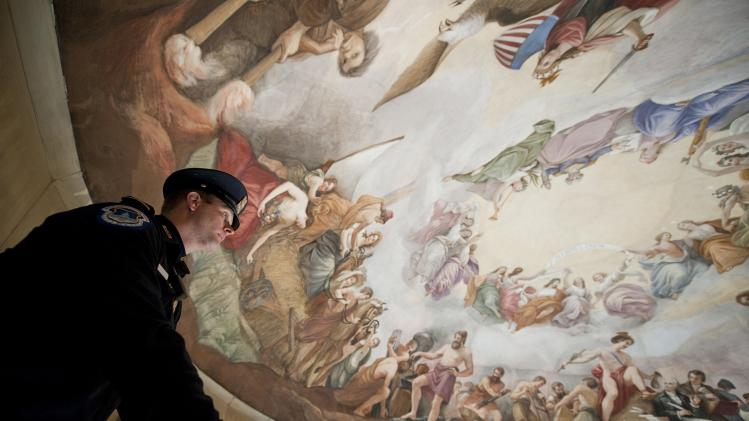 "Police officer looks at Brumidi's painting ""The Apotheosis of Washington"" on ceiling of the U.S. Capitol's rotunda in Washington"