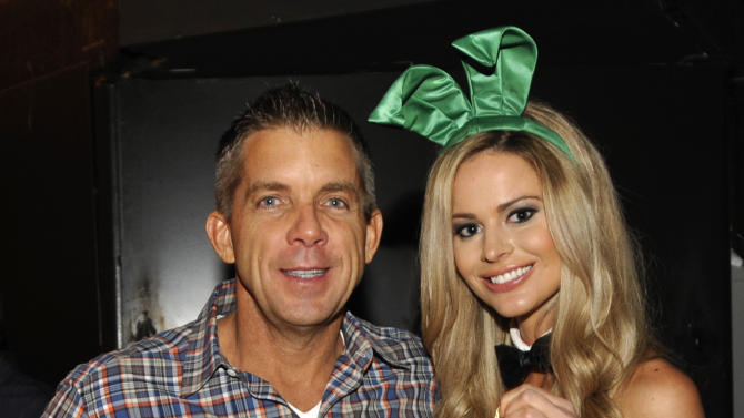 IMAGE DISTRIBUTED FOR CROWN ROYAL - New Orleans Saints head coach Sean Payton stuffs a Crown Royal camo care package for U.S. troops overseas during the Playboy Party presented by Crown Royal, Friday, Feb. 1, 2013, in New Orleans. The packages will be shipped as part of the Crown Royal Heros Project honoring American soldiers. (Photo by Jack Dempsey/Invision for Crown Royal/AP Images)