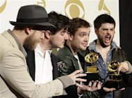 Mumford & Sons pose with their awards for Album of the Year for &quot;Babel&quot; and Best Long Form Music Video for &quot;Big Easy Express&quot; backstage at the 55th annual Grammy Awards in Los Angeles, California February 10, 2013. REUTERS/Jonathan Alcorn