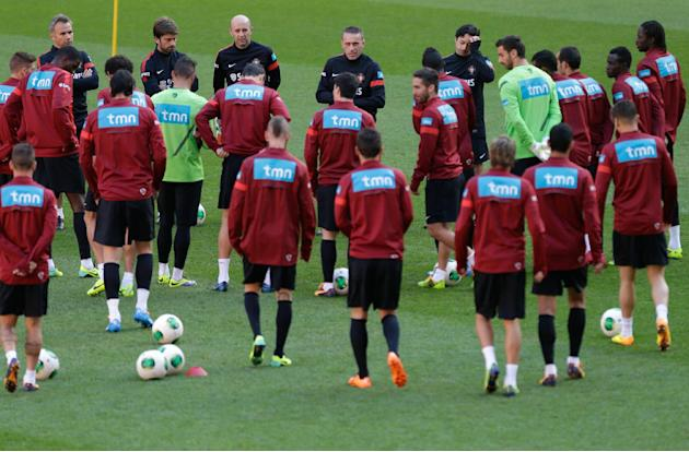 Portugal's coach Paulo Bento, background center, gathers the players for a training session Sunday, Nov. 17 2013, at the Luz stadium in Lisbon. Portugal will play Sweden on Tuesday in a World Cup qual