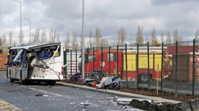 A view shows the wreckage of a school minibus after it crashed into a metal panel which fell from a truck in Rochefort