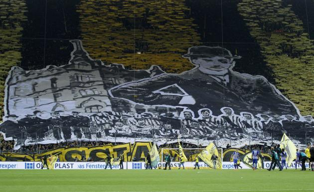 Borussia Dortmund's supporters cheer their team before the German first division Bundesliga soccer match against Hertha Berlin in Dortmund
