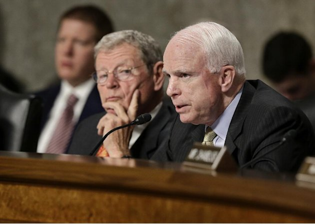 FILE - In this Feb. 7, 2013, file photo, Senate Armed Services Committee member Sen. John McCain, R-Ariz., right, questions Defense Secretary Leon Panetta and Joint Chiefs Chairman Gen. Martin Dempsey