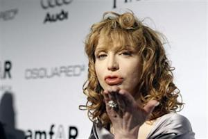 Musician Courtney Love blows a kiss at photographers at amfAR's Inspiration Gala Los Angeles fundraiser in Los Angeles