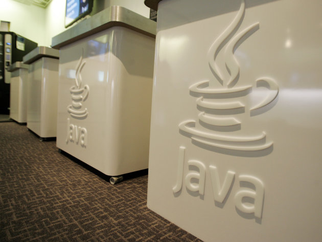 FILE- This April 23, 2007 file photo shows the Java logo at Sun Microsystems' offices in Menlo Park, Calif. On Monday, Jan. 14, 2013, Oracle says it has released a fix for the flaw in its Java softwar