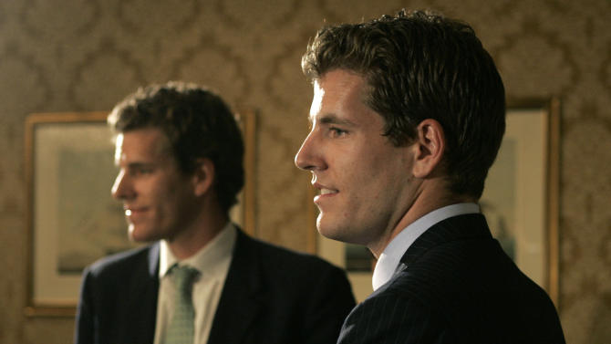 FILE - In this July 25, 2007 file photo, twin brothers Cameron, left, and Tyler Winklevoss, founders of ConnectU, talk with reporters following a news conference in Boston. Cameron and Tyler Winklevoss are no strangers to the spotlight. After waging a closely watched legal battle with Facebook Inc., the Greenwich, Conn., natives and Olympic rowers know all too well what it's like to be scrutinized in newspapers, blogs and books. Now they're preparing to see their story told once again, this time, on the big screen. (AP Photo/Charles Krupa, File)