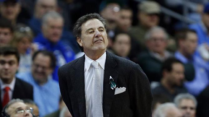 Louisville head coach Rick Pitino reacts during the first half of an NCAA college basketball game against Seton Hall, Wednesday, Jan. 9, 2013, in Newark, N.J. Louisville won 73-58. (AP Photo/Julio Cortez)