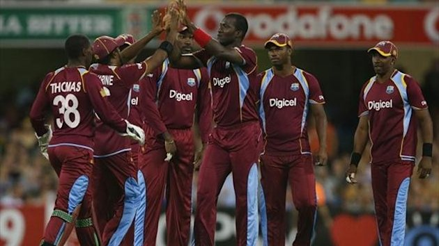 Darren Sammy of West Indies celebrates with team mates after dismissing Aaron Finch of Australia during the International Twenty20 match between Australia and the West Indies at The Gabba