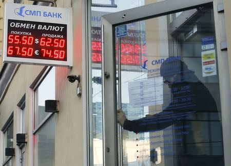 Russian central bank seen holding rates for now despite economic slump: Reuters poll
