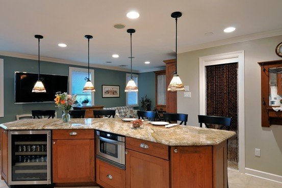<p>A V-shaped island with arm's-reach appliances for entertaining all ages. Photo: Showcase Kitchens</p>