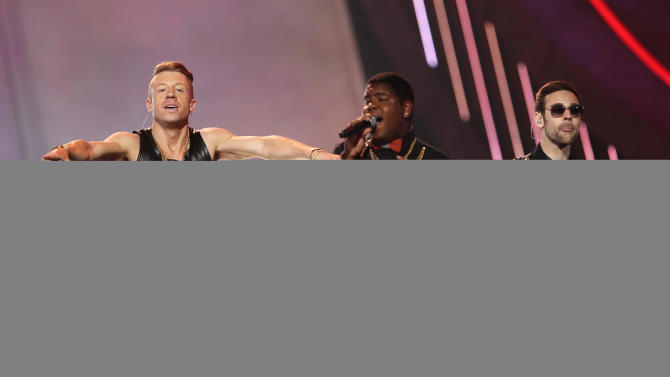 "FILE - This April 14, 2013 file photo shows Macklemore, left, and Ryan Lewis, right, performing ""Can't Hold Us"" with Ray Dalton at the MTV Movie Awards in Sony Pictures Studio Lot in Culver City, Calif. The song was the top streamed track on Spotify from Monday, April 29, to Sunday, May 5. (Photo by Matt Sayles/Invision /AP)"