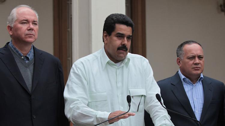 "In this photo released by Miraflores Press Office, Venezuela's Vice President Nicolas Maduro, center, addresses the nation on live television flanked by Oil Minister Rafael Ramirez, left, and National Assembly President Diosdado Cabello at Miraflores presidential palace in Caracas, Venezuela, Wednesday, Dec. 12, 2012.  Maduro said that Chavez will face a ""complex and hard"" process after undergoing his fourth cancer-related operation in Cuba on Tuesday. Over the weekend, Chavez named Maduro as his chosen political heir. (AP Photo/Miraflores Press Office, Efrain Gonzalez)"
