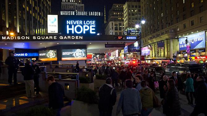 """People gather before the """"12-12-12"""" benefit concert at Madison Square Garden in New York Wednesday, Dec. 12, 2012. Music royalty from the Rolling Stones to Kanye West are gathering at Madison Square Garden Wednesday for a benefit concert to help storm victims. (AP Photo/Craig Ruttle)"""