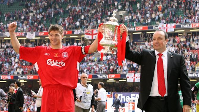 Liverpool manager Raphael Benitez (R) and captain Steven Gerrard lift the FA Cup after Liverpool beat West Ham 3-1 on penalties during the FA Cup final at the Millennium Stadium in Cardiff, May 13, 2006