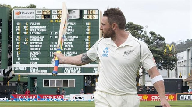 Captain of New Zealand Brendon McCullum walks from the field after being dismissed for 302against India in Wellington (AFP)