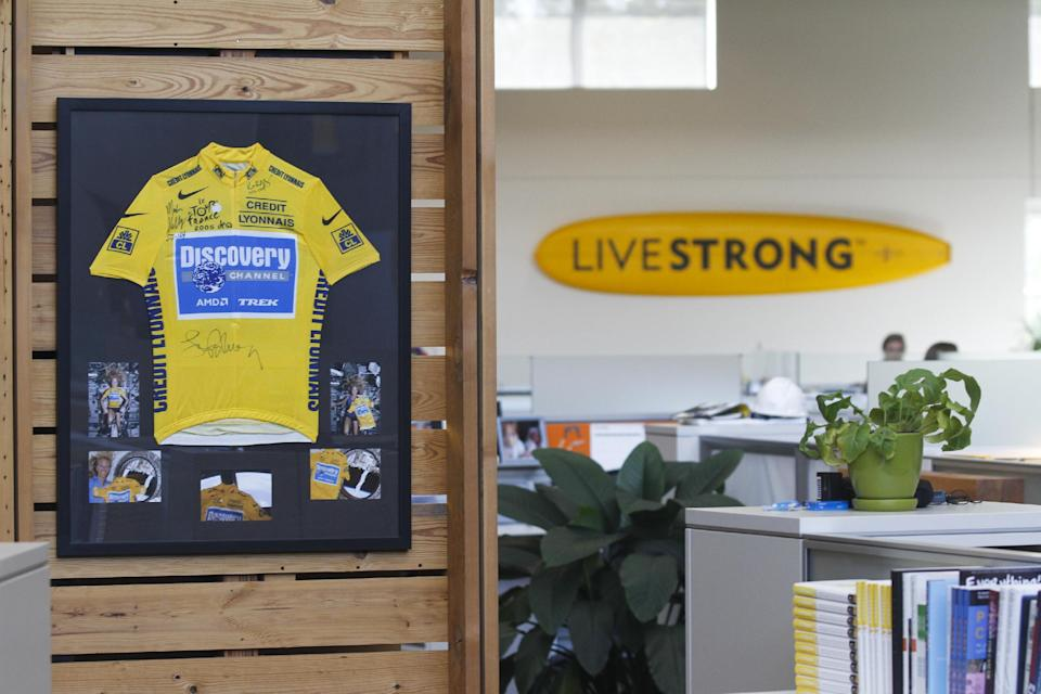 An autographed cycling jersey hangs in the offces of Livestrong, Lance Armstrong's cancer-fighting charity, Wednesday, Oct. 17, 2012, in Austin, Texas. Armstrong stepped down as chairman of Livestrong on Wednesday.(AP Photo/Jack Plunkett)