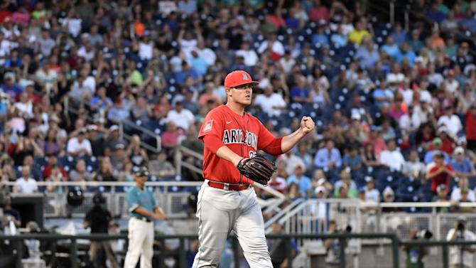Arizona pitcher JC Cloney reacts to a double play against Coastal Carolina in the ninth inning in Game 1 of the NCAA Men's College World Series finals baseball game in Omaha, Neb., Monday, June 27, 2016. Arizona won 3-0. (AP Photo/Ted Kirk)
