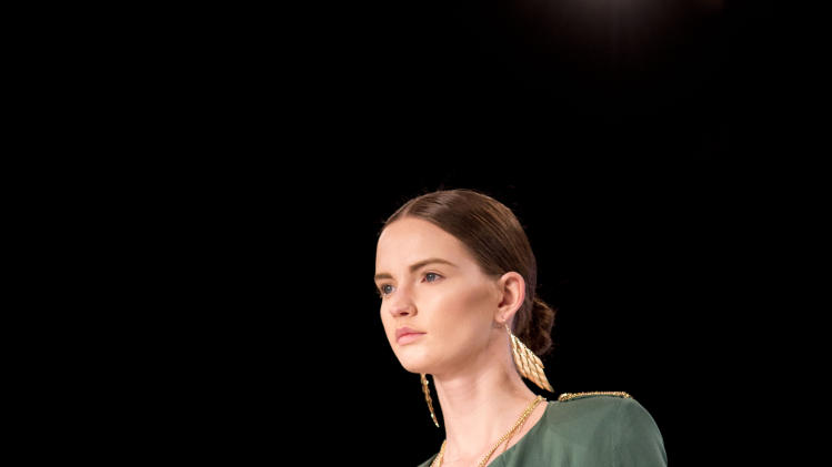 A model wears a creation of Israeli upcoming designer Yoav Rish during a show at the Tel Aviv fashion week, Israel, Wednesday, March 12, 2014. (AP Photo/Ariel Schalit)