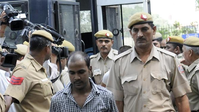 Indian police escort Mukesh Singh -- one of four men condemned to death for the murder and gang-rape of an student in new Delhi -- after his 2013 trial at the High Court in New Delhi