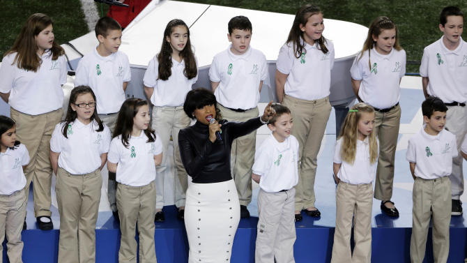 "FILE - In this  Feb. 3, 2013 file photo, Jennifer Hudson performs with students from Sandy Hook Elementary School singing ""America the Beautiful"" before the NFL Super Bowl XLVII football game between the San Francisco 49ers and the Baltimore Ravens in New Orleans.  In the weeks since the school shooting, the music world has helped the town come together and heal. (AP Photo/Gerald Herbert, File)"