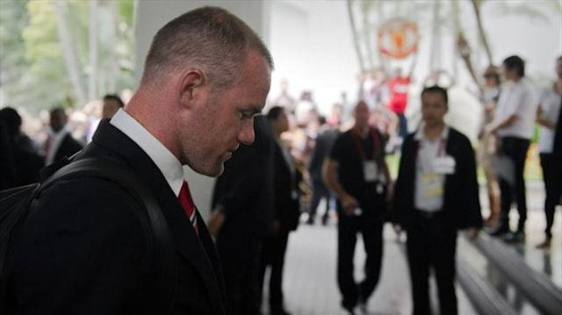 Manchester United's Wayne Rooney arrives at the Four Seasons hotel in Bangkok (AFP)