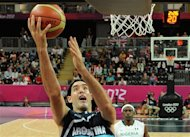 Argentina's forward Luis Scola scores during a men's preliminary round basketball match against Nigeria at the 2012 Summer Olympics, on Saturday, Aug. 4, 2012, in London. (AP Photo/Timothy A. Clary, Pool)