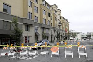 Police tape blocks off a section of Kittredge Street…