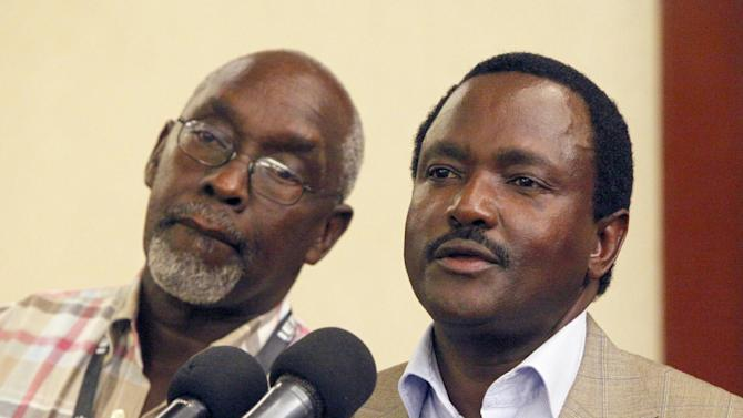 Kenyan Vice president and running mate for Coalition for Reforms and Democracy, CORD, Kalonzo Musyoka,  right addresses journalists at a hotel In Nairobi, Kenya Tuesday, March 5, 2013, as the result of the Kenyan election start pouring in at the IEBC headquarters in Nairobi.  At left,  Franklin Bett .(AP Photo/Sayyid Azim)