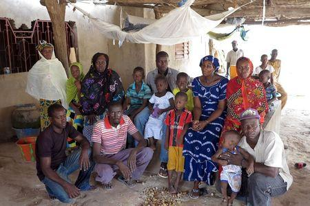 Nfamara Diawarra poses for a picture with his family in Segoucoura, Senegal