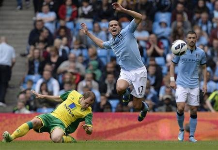 Norwich City's Whittaker challenges Manchester City's Rodwell during their English Premier League soccer match in Manchester