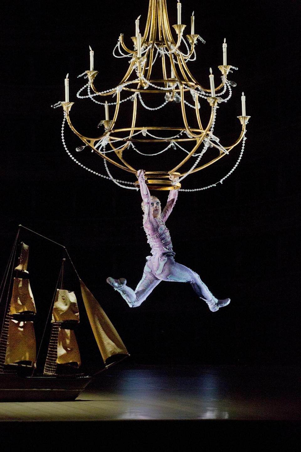 "In this Oct. 15, 2012 photo provided by the Metropolitan Opera, acrobat Jaime Verazin performs as Ariel during a dress rehearsal of Thomas Adès's ""The Tempest,"" at the Metropolitan Opera in New York. (AP Photo/Metropolitan Opera, Ken Howard)"